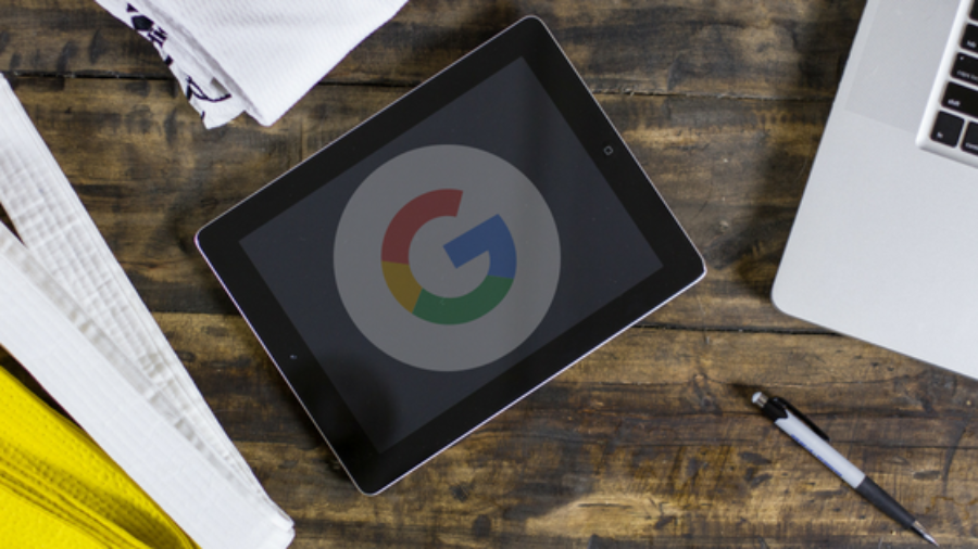 a tablet on a desk showing the google logo